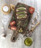Salsiccie fritte con l'olio di olive Fotografia Stock Libera da Diritti