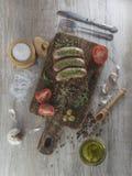 Salsiccie fritte con l'olio di olive Fotografia Stock