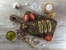 Salsiccie fritte con l'olio di olive Fotografie Stock