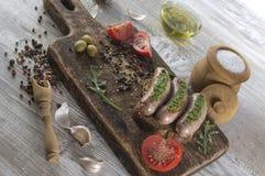 Salsiccie fritte con l'olio di olive Immagine Stock Libera da Diritti