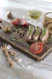 Salsiccie fritte con l'olio di olive Fotografie Stock Libere da Diritti