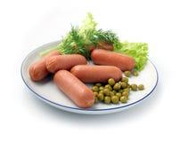 Salsiccie su un piatto bianco Immagine Stock Libera da Diritti