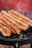 Salsiccie su una griglia Fotografia Stock Libera da Diritti