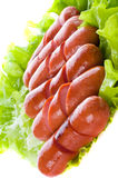Salsiccie su una griglia Immagini Stock Libere da Diritti
