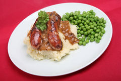 Salsicha & batata triturada Imagem de Stock