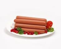 Salsicha com airela e tomate. Foto de Stock