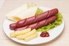 Salsicha com batata Imagem de Stock