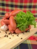 Salsicha com verdes Fotos de Stock Royalty Free
