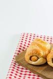 Salsicha cozida na massa na placa de madeira Imagens de Stock Royalty Free