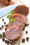 Salsicha e faca Imagem de Stock Royalty Free