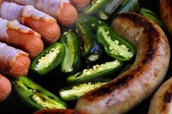 Salsicha e pimentas Fotografia de Stock