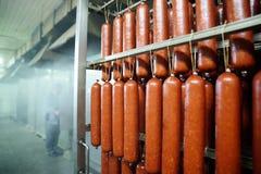 Salsicha fumado no fumeiro Fotografia de Stock Royalty Free