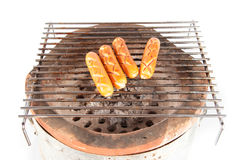 Salsicha grelhada sobre uma grade quente do assado Imagens de Stock