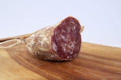 Salsicha no trencher de madeira Imagem de Stock Royalty Free