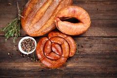 Salsicha, pão e especiarias Fotos de Stock Royalty Free