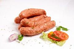 Salsichas com legumes frescos Foto de Stock Royalty Free