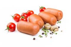 Salsichas com tomates Fotos de Stock Royalty Free