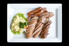 Salsichas cortadas Imagens de Stock