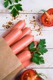 Salsichas cruas na casca Imagens de Stock Royalty Free