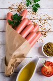 Salsichas cruas na casca Imagem de Stock Royalty Free