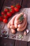 Salsichas cruas no dipper Fotos de Stock