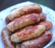 Salsichas de carne de porco assadas na placa Imagens de Stock Royalty Free