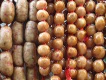 Salsichas de carne de porco cruas Imagem de Stock