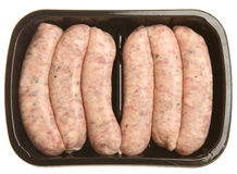Salsichas de carne de porco na bandeja de empacotamento do supermercado Fotografia de Stock