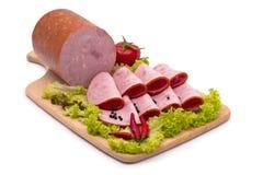 Salsichas deliciosas, decoradas com vegetais Foto de Stock Royalty Free