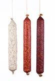 Salsichas do salame da seleção isoladas no fundo branco Imagem de Stock Royalty Free