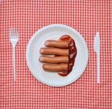 Salsichas e ketchup fotos de stock royalty free