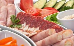 Salsichas e vegetais Assorted Imagem de Stock