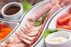 Salsichas e vegetais Assorted Foto de Stock