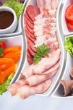 Salsichas e vegetais Assorted Imagem de Stock Royalty Free
