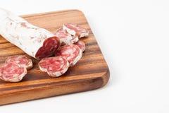 Salsichas espanholas no fundo textured de madeira Imagem de Stock Royalty Free