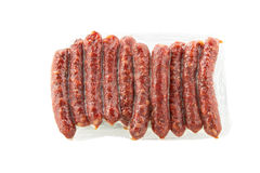 Salsichas fumado envolvidas no plástico Imagens de Stock Royalty Free
