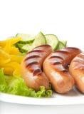 Salsichas na grade Fotos de Stock