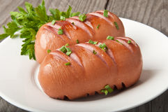 Salsichas na grade Fotografia de Stock