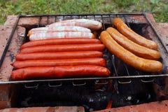 Salsichas no assado Fotografia de Stock