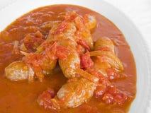 Salsichas no molho de tomate. Imagem de Stock