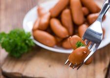 Salsichas pequenas na madeira Fotos de Stock Royalty Free