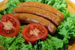 Salsichas uma grade Foto de Stock