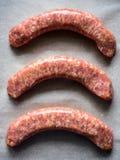 Salsichas Uncooked Fotografia de Stock