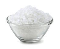 Salt. Glass bowl of salt isolated on white stock photo