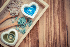 Salt and aromatic candles. In wooden tray on a wooden background Stock Images