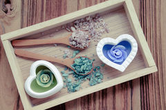Salt and aromatic candles. In wooden tray on a wooden background Royalty Free Stock Photo