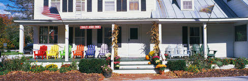 Salt Ash Inn. This is the Salt Ash Inn Bed and Breakfast. It is a large white house with a large front porch. There are brightly colored wooden chairs on the royalty free stock image