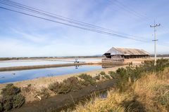 Salt barn and sea salt pans. Petchaburi province, Thailand stock image