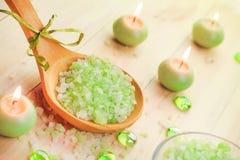 Salt bath scented candles table Stock Photos