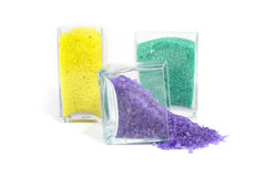 Salt for baths. Colour salt for baths in transparent glass capacities Stock Images